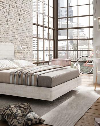 Amueblamiento moderno de habitación con zona de trabajo integrada.